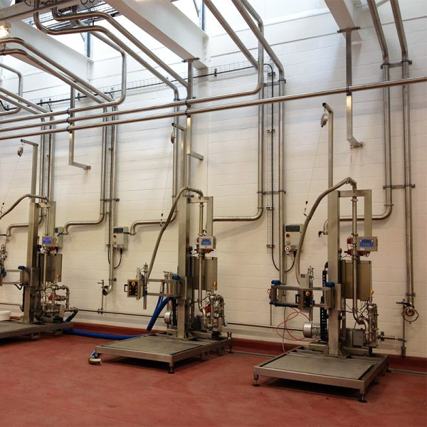 Three FT-100 Liquid Filling Systems Ready to Fill Drums, Pails, and IBC's